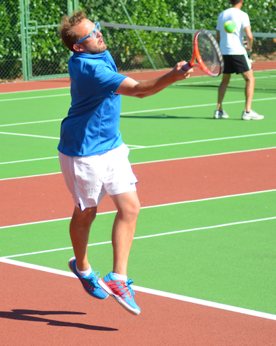 Bill Ingram playing tennis at local club, sport